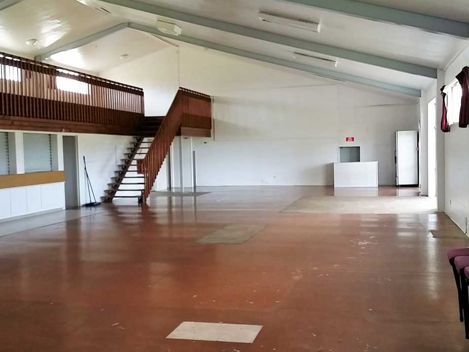 Picture take from south end of the building.  Access to the changing room at the far end of the hall.  Toilets located below stairs.