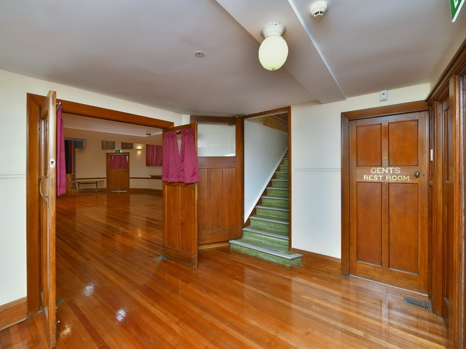 Main Hall - old front foyer, stairs to mezzanine