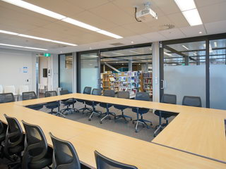 Meeting Room One with doors to Library open - opposite view