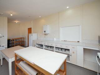 Kitchen - Servery window & doorway to Hall