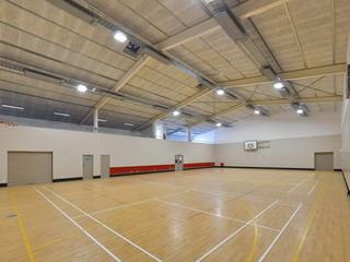 Sport Hall - towards roller storage door, kitchen access doors, entry doors
